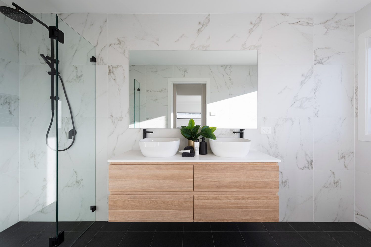 Square set bathroom with marble walls