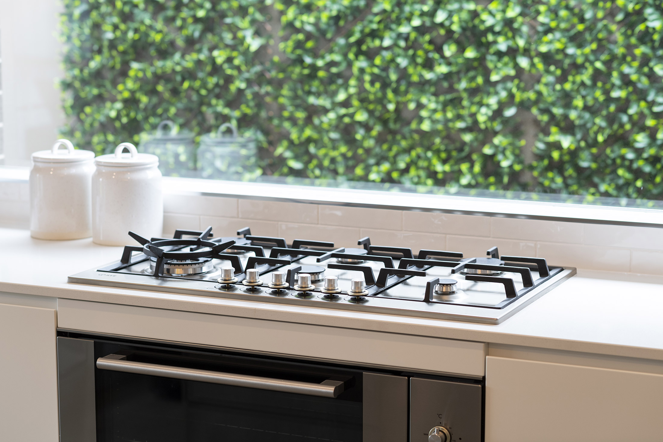 Stove built into white kitchen counters