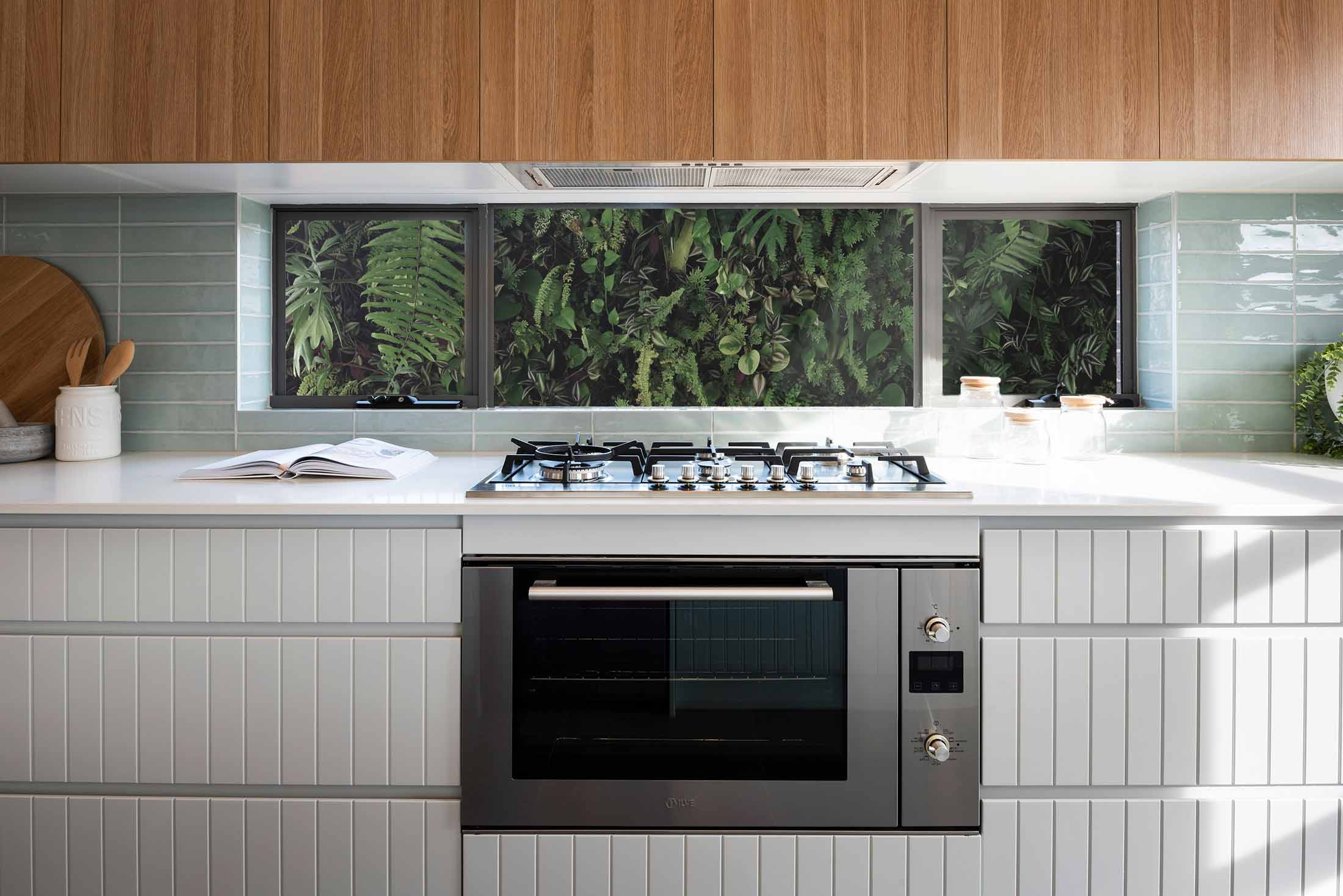 Oven and stove built into white kitchen counters