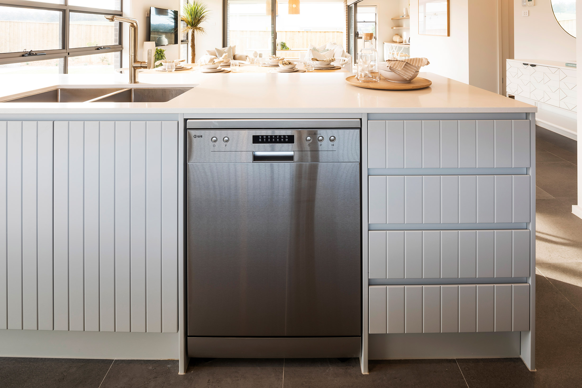 Built in dishwasher in white kitchen counters