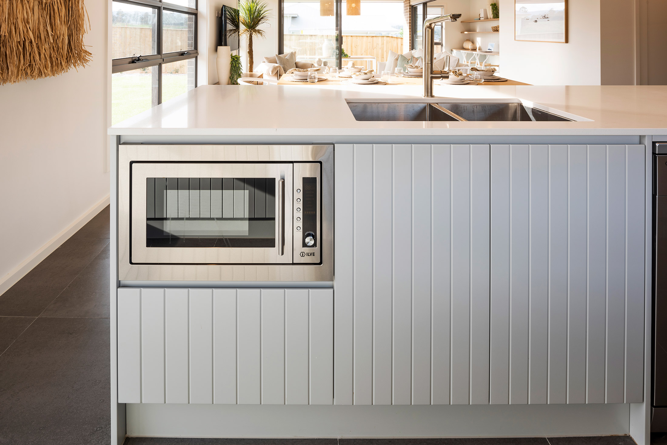 Built in microwave in white kitchen counters