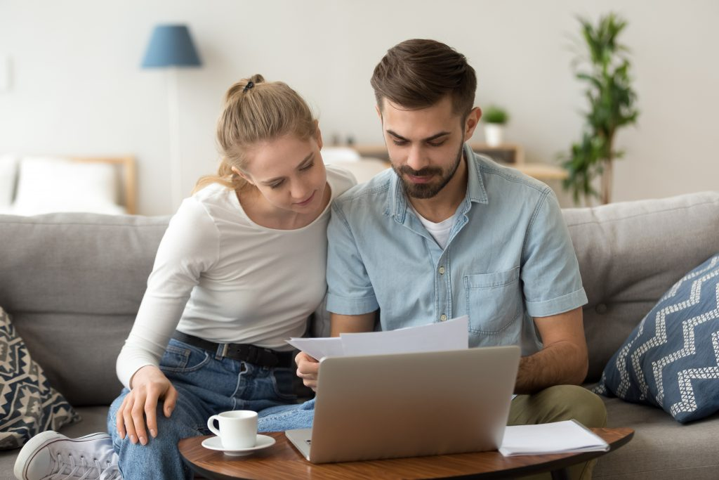Young couple researching builders